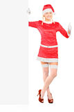 Female santa claus holding a panel Royalty Free Stock Photo