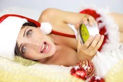 Female santa claus late for christmas Stock Photo