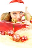 Female Santa Claus playing with little toy of real Santa Stock Images