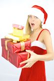 Female santa claus scared of falling gifts Royalty Free Stock Image