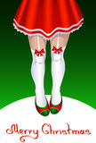 Female Santa Claus with slender legs in stockings Royalty Free Stock Photography