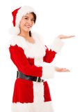 Female Santa displaying something Royalty Free Stock Image