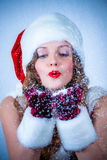Female Santa enjoying a snowy Christmas Royalty Free Stock Photography