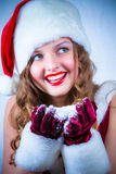 Female Santa enjoying a snowy Christmas Stock Photography