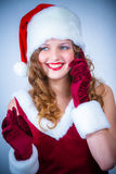 Female Santa enjoying a snowy Christmas and cellular Stock Photography
