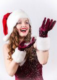 female Santa enjoying a snowy Christmas Royalty Free Stock Photos