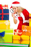 Female Santa exploring Christmas gift Royalty Free Stock Photos