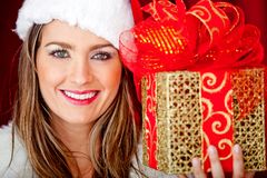 Female Santa with a gift Royalty Free Stock Images
