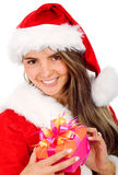 Female santa with a gift Stock Photos