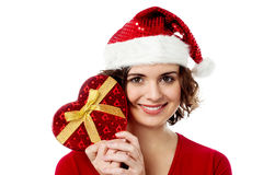 Female santa with gift box Stock Image