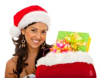 Female Santa with a gift's bag Royalty Free Stock Photos