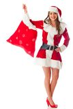 Female Santa with gift sack Royalty Free Stock Photography