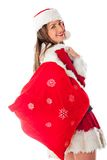 Female Santa with gift sack Stock Photography