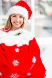 Female Santa with a gift sack Royalty Free Stock Photography