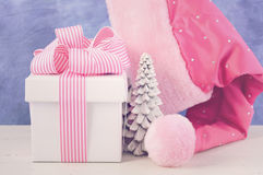 Female Santa Hat with pink and white gift. Royalty Free Stock Photography