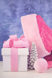 Female Santa Hat with pink and white gift. Royalty Free Stock Photos