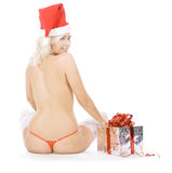 Female in santa hat and white stockings Royalty Free Stock Images