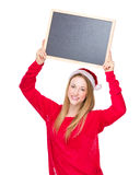 Female santa hold with chalkboard Royalty Free Stock Photography