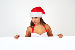 Female santa holding banner Royalty Free Stock Photos