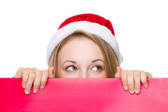 Female santa holding  christmas red card Stock Photo