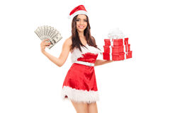Female Santa holding presents and money Royalty Free Stock Image