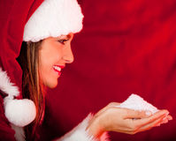 Female Santa holding snow Royalty Free Stock Photo