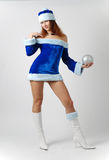 Female Santa In Fancy Dress On Light Background Stock Image