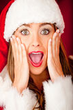 Female Santa looking surprised Stock Photography