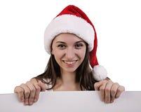 Female santa over a billboard Stock Photos