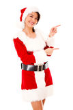 Female Santa pointing Royalty Free Stock Photography