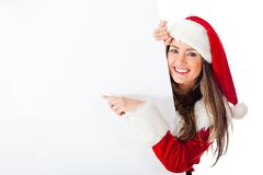 Female Santa pointing at a banner Stock Photo