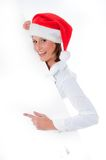 Female Santa pointing down at blank billboard. Happy Female Santa pointing down at blank billboard, isolated background Royalty Free Stock Photo