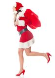 Female Santa running with gifts Royalty Free Stock Photos