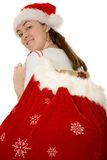 Female santa with sack of gifts Stock Photography