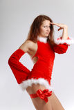 Female Santa in sexual red dress Royalty Free Stock Images