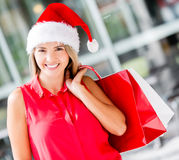 Female Santa shopping Royalty Free Stock Images