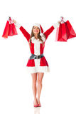 Female Santa with shopping bags Royalty Free Stock Image