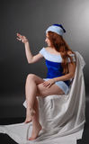 Female Santa with small watch. Royalty Free Stock Image