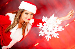 Female Santa with a snowflake Royalty Free Stock Photos