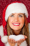 Female Santa under falling snow Royalty Free Stock Photography