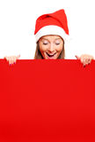 Female Santa wit red board Royalty Free Stock Photography
