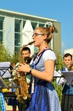 German female saxophone player is exhibiting at the EXPO Milano 2015. Stock Photo