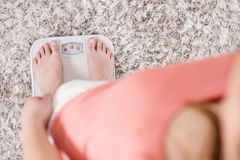 Female On Scale Measuring Weight Loss Stock Photos