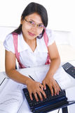 Female scholar typing Stock Images