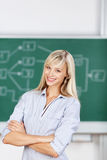 Female in school with arms crossed Stock Photo