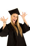 Female school graduate in cap and gown celebrating Royalty Free Stock Image