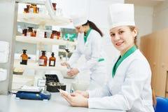 Female scientific pharmacy worker preparing medicine drug royalty free stock photo