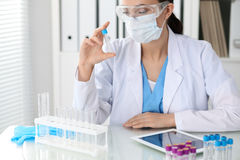 Female scientific research is looking at the tube in laboratory Royalty Free Stock Image