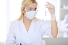Female scientific research team with clear solution in laboratory Royalty Free Stock Photography