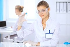 Female scientific researcher or blood test assistant in laboratory. Medicine concept Stock Images
